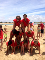 Human towers at the beach